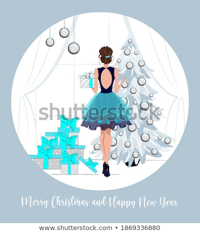 elegant girl dressed for christmas Stock photo © carlodapino