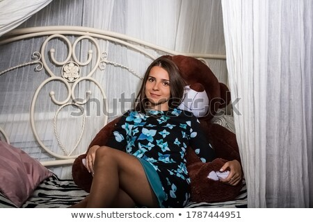 young woman posing with large teddy bear stock photo © acidgrey