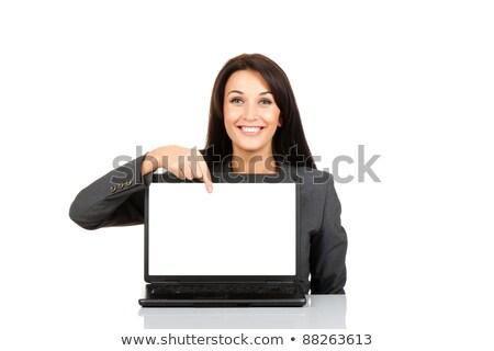 vrouw · wijzend · vinger · laptop · scherm · glimlachend - stockfoto © ra2studio