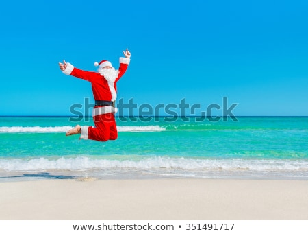 Stock photo: Flying santa tourist