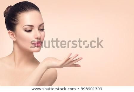 jovem · bela · mulher · abrir · palms · estúdio · retrato - foto stock © rosipro