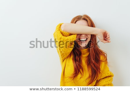 Woman holding arms on her head while smiling stock photo © wavebreak_media