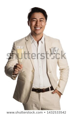 businessman holding money in cash and a glass of champagne stock photo © photography33