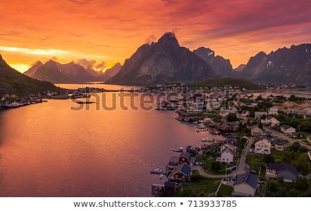 éjfél nap Norvégia festői óceán szigetek Stock fotó © Harlekino