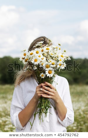 funny girl with a bunch of flowers Stock photo © balasoiu
