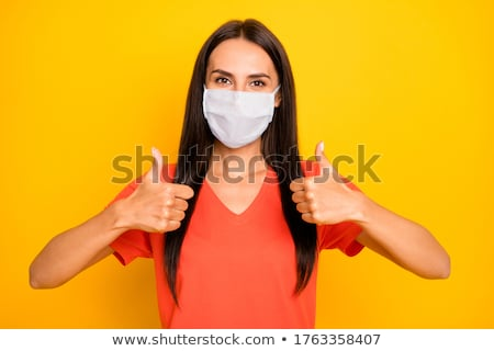 Stock photo:  Woman showing double thumbs up