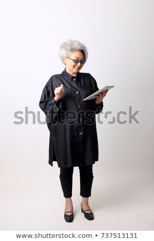 businesswoman full lenght portrait with tablet Stock photo © chesterf