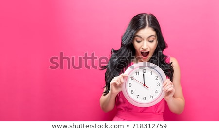 lady holding alarm clock Stock photo © get4net