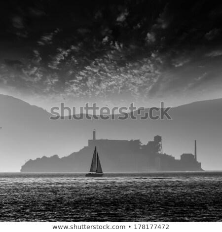 alcatraz island penitentiary at sunset backlight in san francisc stock photo © lunamarina