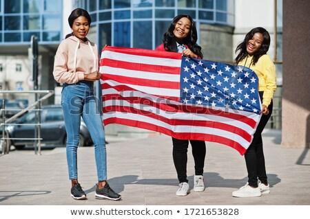 Beautiful patriotic woman with an American flag Stock photo © stryjek