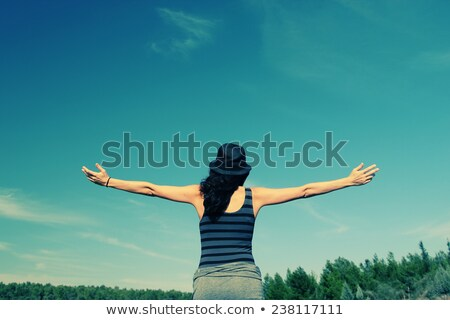 Positive woman looking at white cloud Stock photo © HASLOO