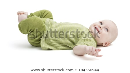 happy toddler lying on his back in green clothing Stock photo © gewoldi