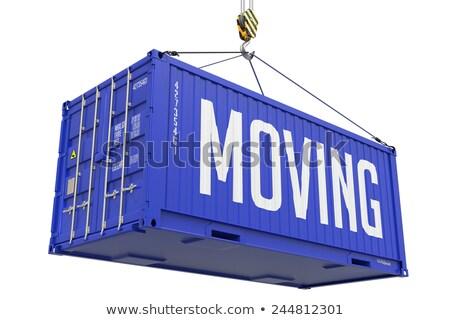 Relocation - Blue Hanging Cargo Container. Stock photo © tashatuvango