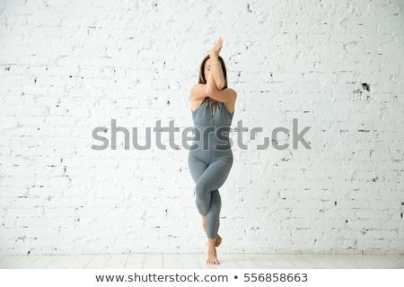 女性 立って イーグル ヨガのポーズ 孤立した 白 ストックフォト © HASLOO