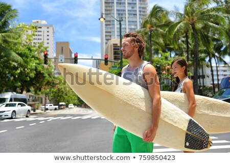 Surfer girl going surfing on Waikiki Beach Hawaii Stock photo © Maridav