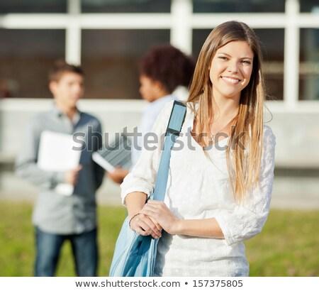 retrato · sonriendo · estudiante · hombro · bolsa · parque - foto stock © andreypopov