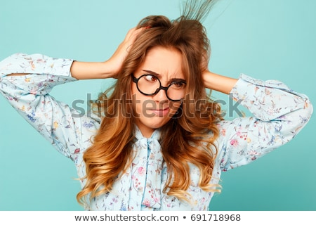 Frustrated stressed woman with glasses pulling her hair out  Stock photo © ichiosea