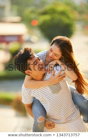 Férfi csinos barátnő malac hát fehér Stock fotó © wavebreak_media
