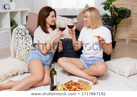 Smiling pretty woman sitting on the floor stock photo © deandrobot