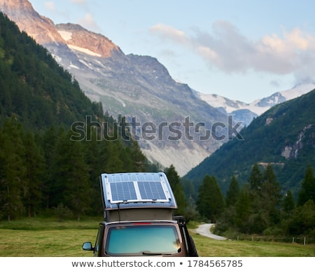 Lakókocsi furgon magas hegyek Svájc hegy Stock fotó © michaklootwijk