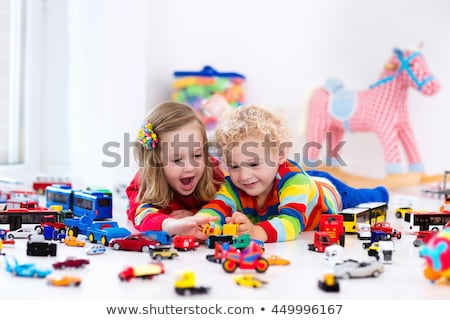 little girl plays with plastic car in kindergarten Stock photo © Paha_L