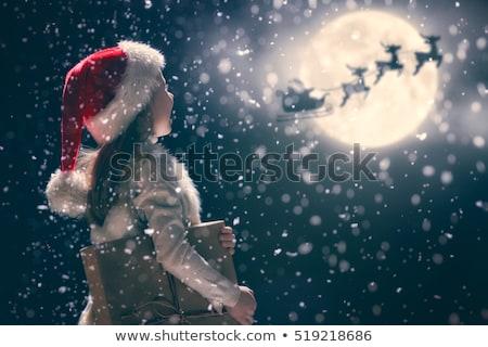 Święty mikołaj magic polu śniegu czerwony świetle Zdjęcia stock © -Baks-