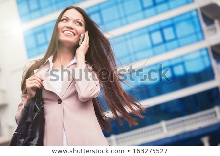 Woman Speaking Cellphone On The Street Stock photo © dash