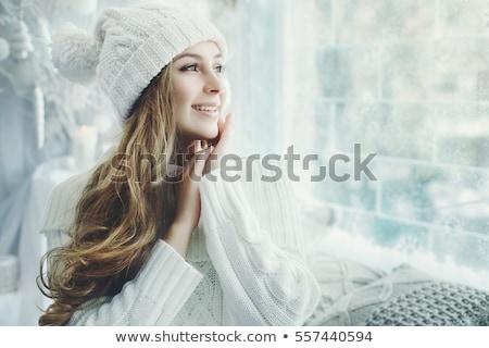 Alegre mulher jovem sorridente tocante bochechas blusa branca Foto stock © deandrobot