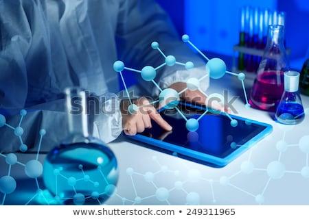 közelkép · tudós · táblagép · labor · tudomány · kémia - stock fotó © dolgachov