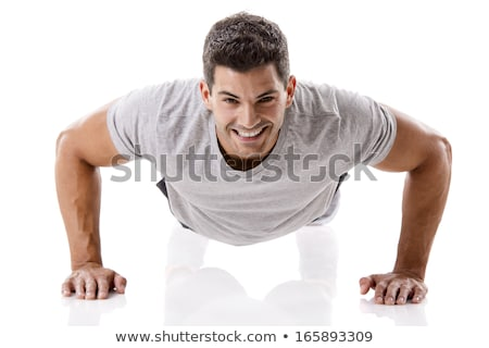 Muscle man making push ups in studio over  white background Stock photo © restyler