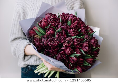 happy beautiful young woman holding bouquet of tulips stock photo © deandrobot