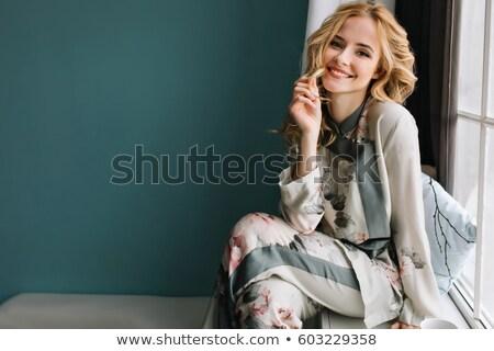 Káprázatos szőke nő ül öltöző szőke nő fiatal nő Stock fotó © deandrobot