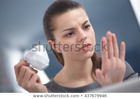 Beautiful woman looks at her palm with red nails Stock photo © filipw