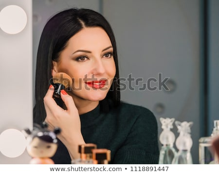 Beautiful middle aged woman with powder stock photo © svetography