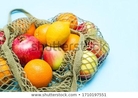 Lemons in net packaging in the grocery store stock photo © vlaru