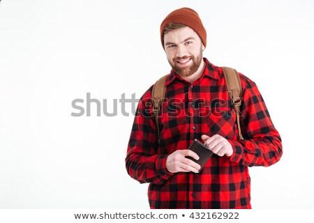 Smiling male traveler holding alcohol flask Stock photo © deandrobot