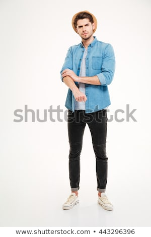 Full length of angry young man rolling up his sleeves Stock photo © deandrobot