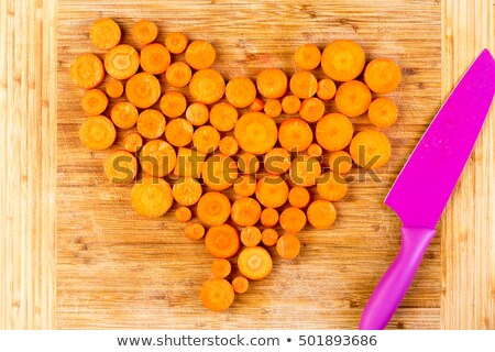 Chopped carrots as heart shape beside knife Stock photo © ozgur