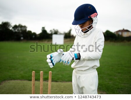 Boy playing cricket on pitch Stock photo © bluering