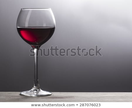 Wineglass with red wine, grey background Stock photo © Alex9500