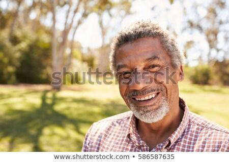 Elöl portré afroamerikai férfi park kamera férfi Stock fotó © deandrobot