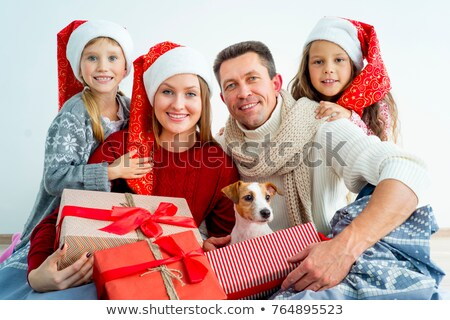 Happy mother and child with dog on Christmas Day Stock photo © dash