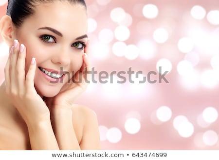 ストックフォト: Woman Smile Closeup Against An Abstract Background