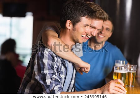 Side view of Drunk friends on bar Stock photo © deandrobot