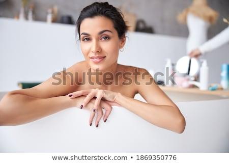 Feliz tenro mulher relaxante banheira espuma Foto stock © deandrobot