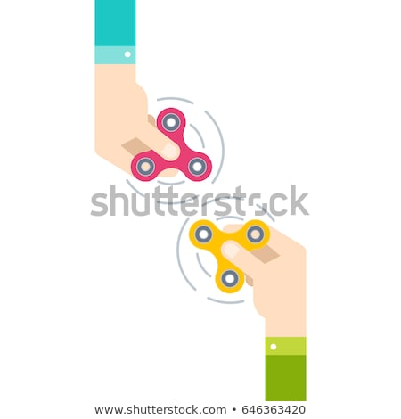 Male hand holding fidget spinner rotating Stock photo © elly_l
