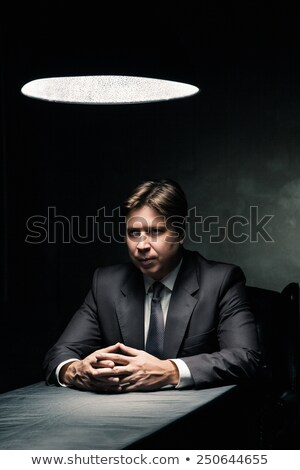 Stockfoto: Side View Of Man In Dark Room Illuminated By Lamp