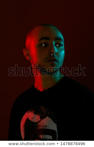 Red bearded man with tattoes studio portrait on dark background Stock photo © julenochek