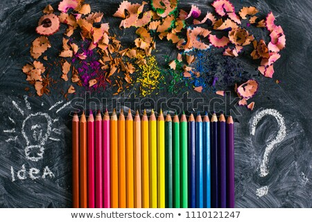 Color pencils lying on black chalkboard Stock photo © Sonya_illustrations