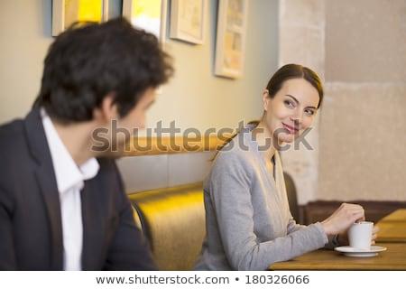 Nő flörtöl üzletember fekete ruha magassarkú láb Stock fotó © LightFieldStudios